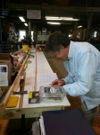 Tim laying out our scale sides and top/ bottom on the layout table with long batten to fair in curves.
