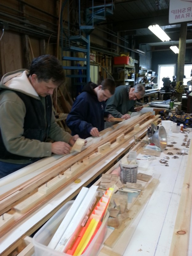 All hands mad dash to glue up all four sides in jig